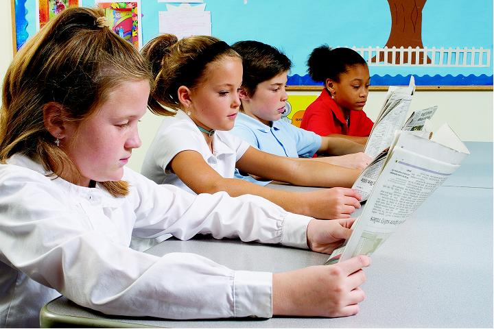 student reading the newspaper